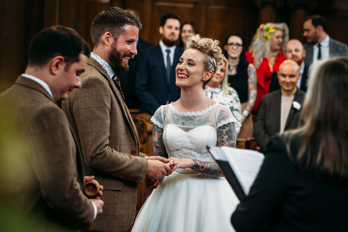 quirky cool alternative tattooed bride blonde plait updo red lip pale skin st pancras islington wedding