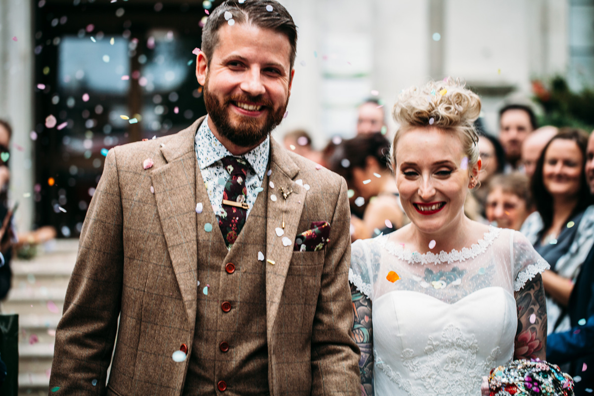 quirky cool alternative tattooed bride blonde plait updo red lip pale skin st pancras islington wedding confetti shot