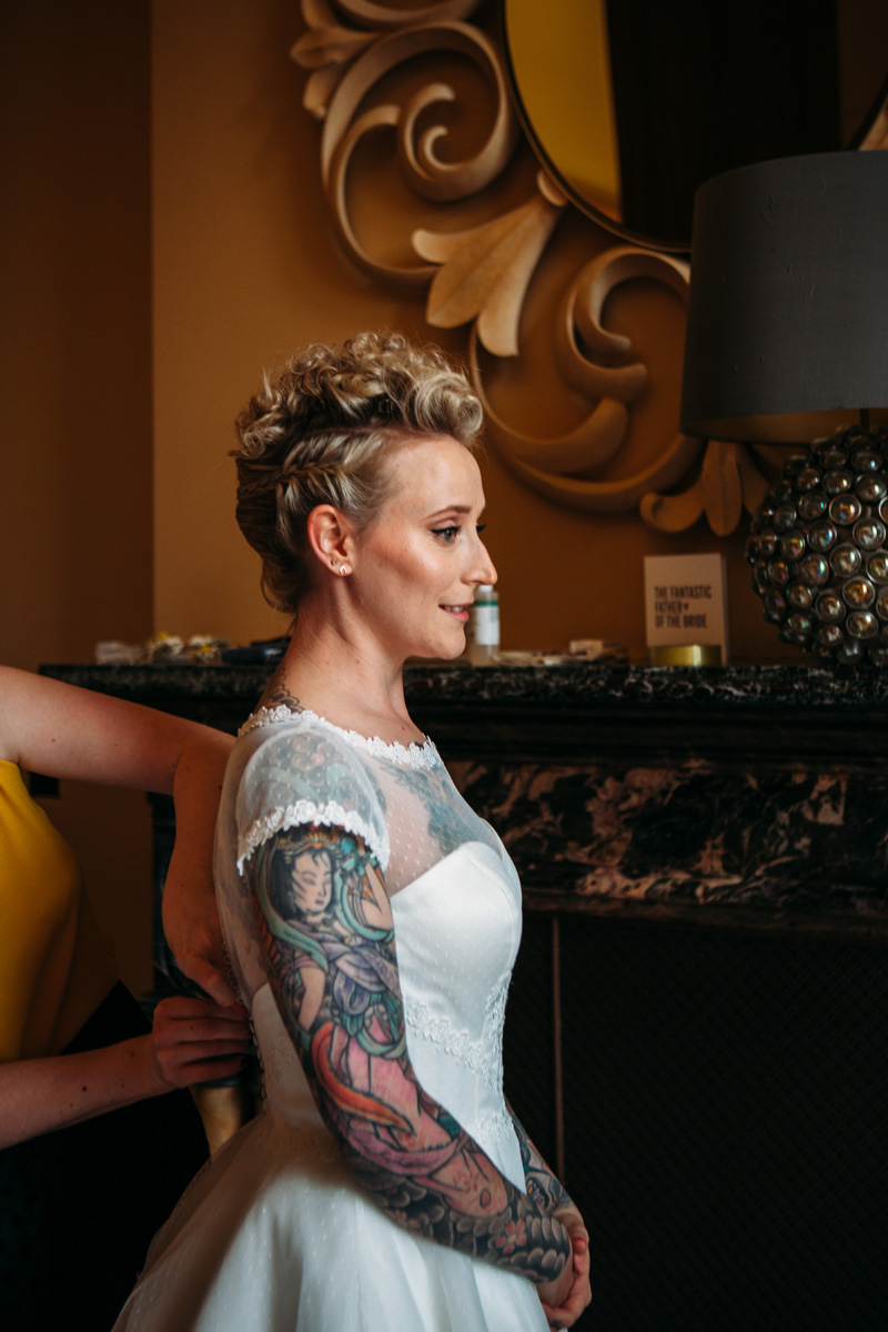 quirky cool edgy alternative tattooed pale natural contoured makeup bride blonde updo with plaits st pancras bridal prep portrait islington wedding kylie mcmichael