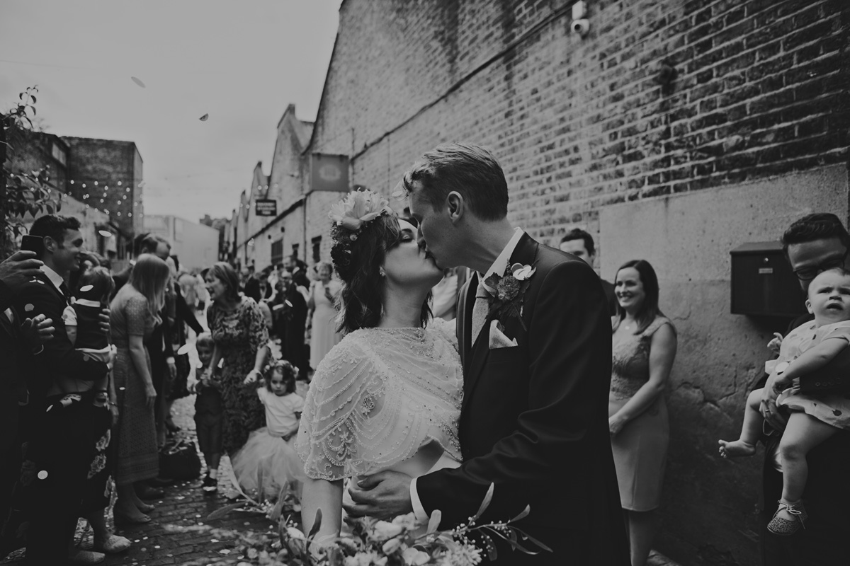 black and white couple kiss portrait boho alternative short wedding hair bridal makeup for brunettes clapton country club flower crown
