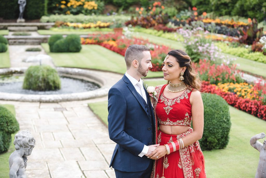 indian mixed faith church wedding hampton court palace sparkly eye makeup soft waves bridal hair
