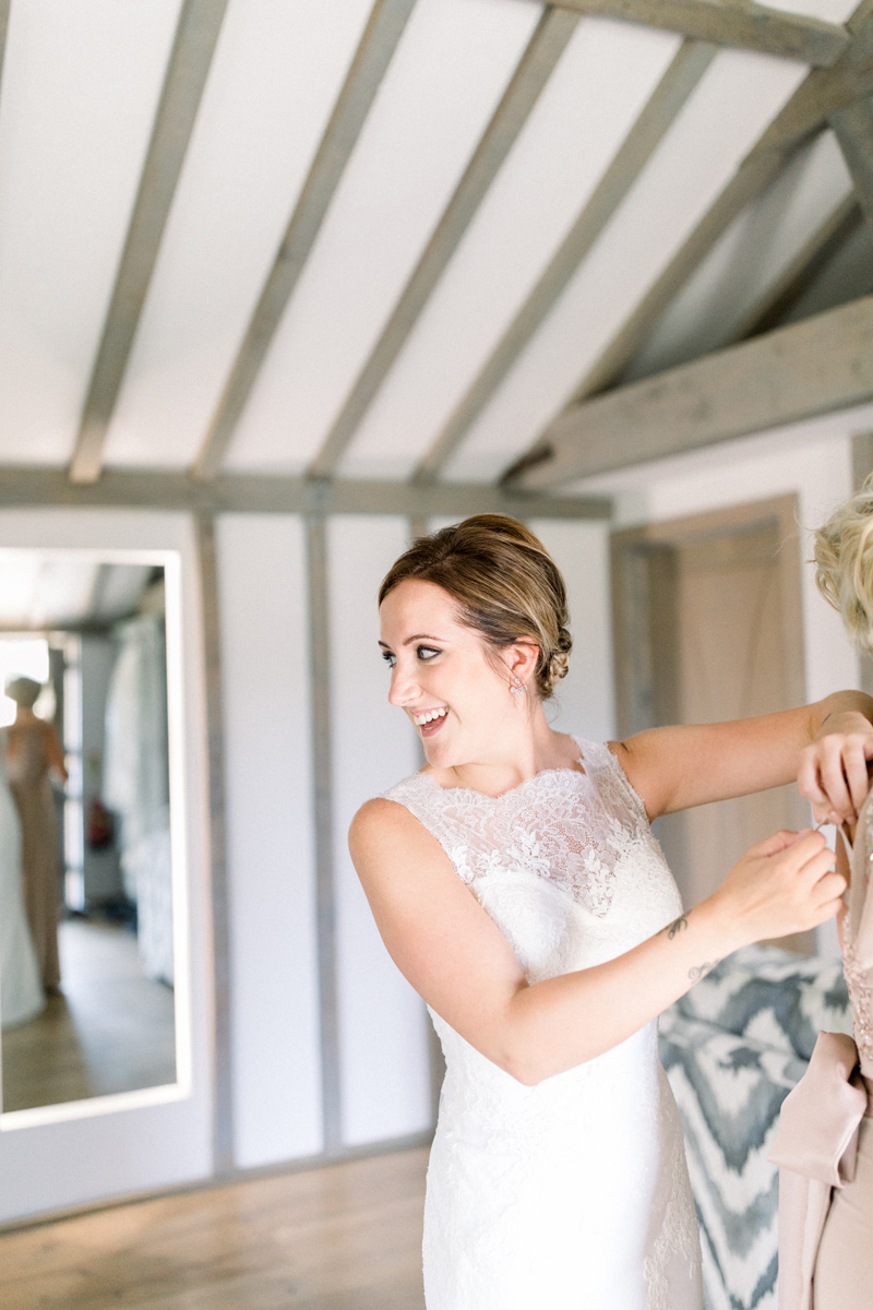 bride plait bun chignon hair ideas natural wedding makeup artist hampton court palace hampton court house syon house london surrey kylie mcmichael