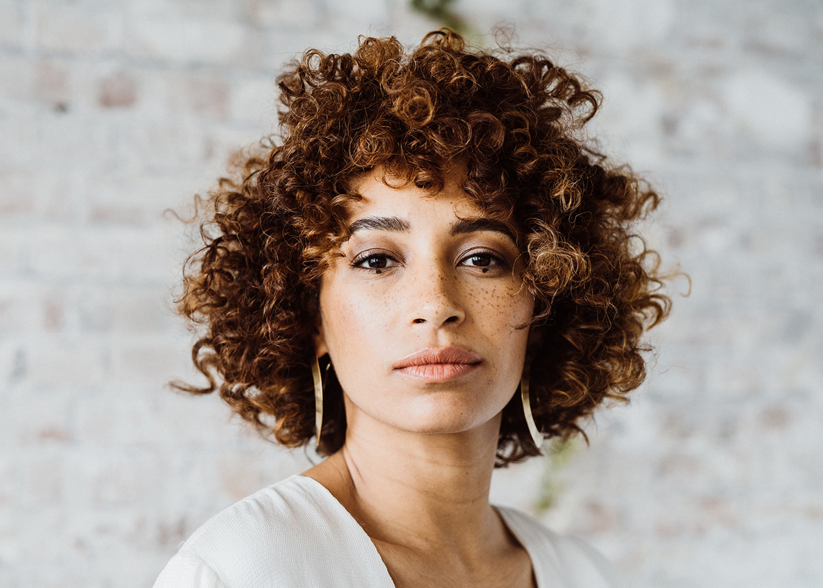natural multi textured coil loose afro wedding hair style natural no makeup makeup with freckles for darker skin and subtle eye detail london surrey middlesex