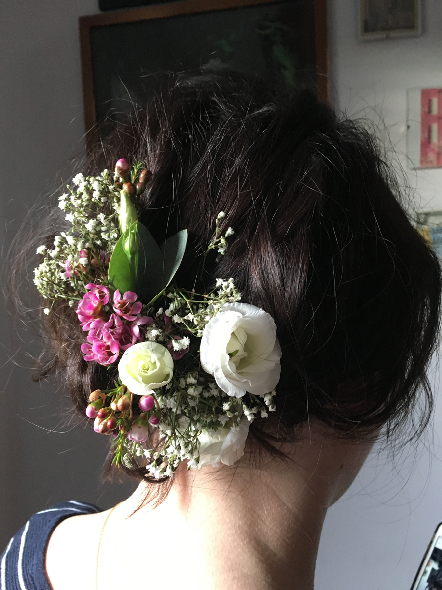 boho up do with flowers wedding hair style